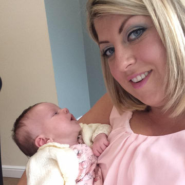 claire henderson holding baby daughter