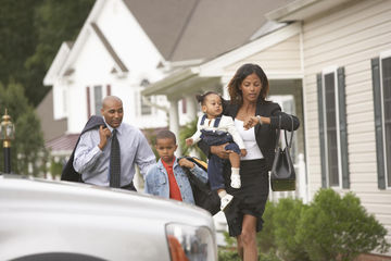 Parents and children rushing off to work and school