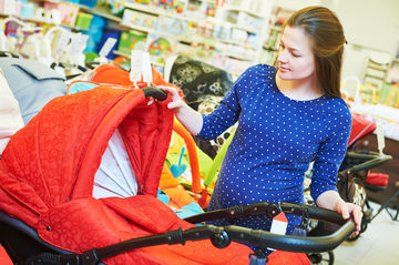 young pregnancy woman shopping for baby gear