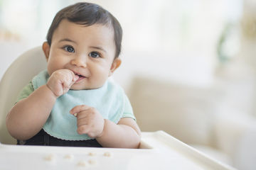 Baby in a high chair eating