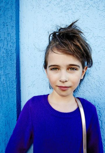 Girl with Short Hair and Blue Shirt