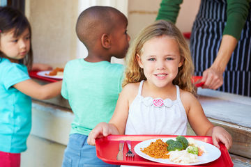 Healthier school lunches Girl with tray of cafeteria food