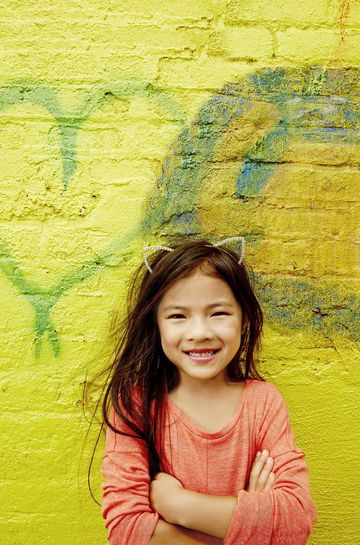 Smiling Girl with Yellow Background