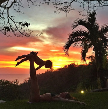 Gisele Bundchen and baby doing yoga at sunset