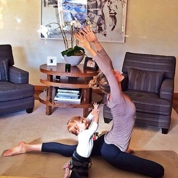 Gisele Bundchen doing yoga with daughter