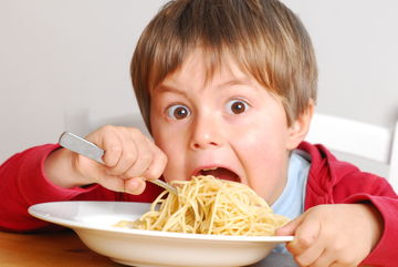Hungry Child Eating Spaghetti