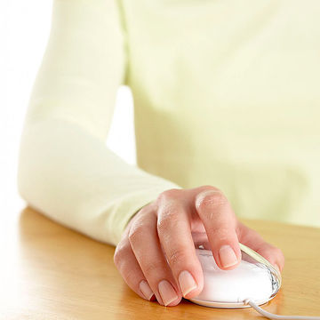 Woman clicking computer mouse