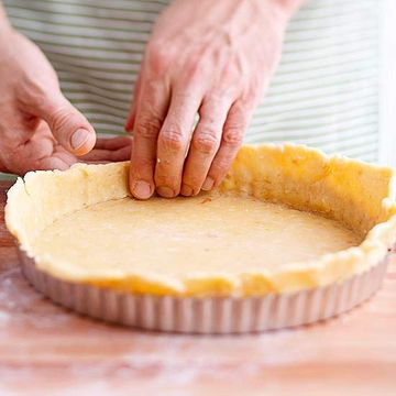 Pressing pastry into tart pan