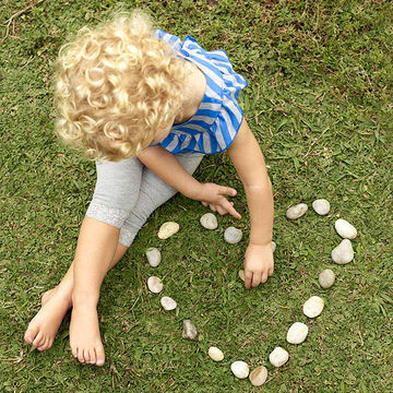 child making a heart