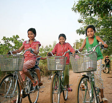 Children on bikes in Mekong Delta, Vietnam