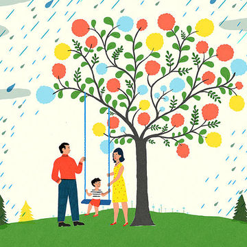 family standing under tree