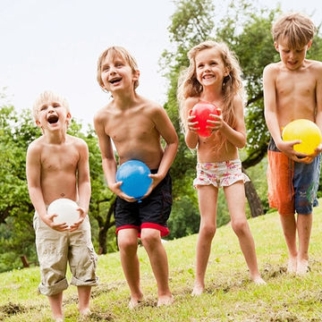 Kids holding water balloons