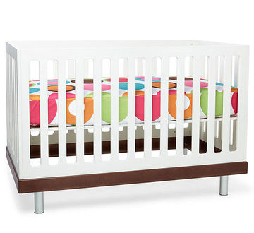Crib with Polka dot Sheet