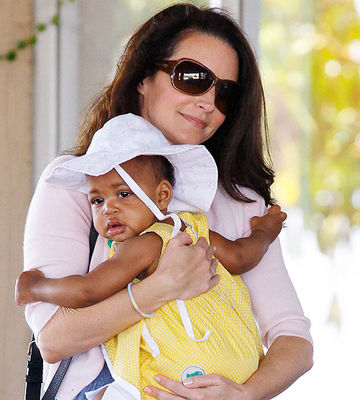 Kristin Davis holding adopted daughter