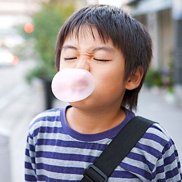 boy blowing bubble