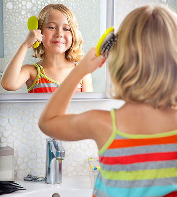 child brushing hair