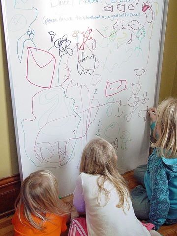 kids coloring on dry-erase board