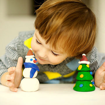 toddler holding Christmas ornament