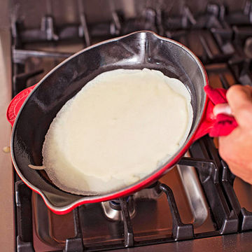 cooking crepe in pan