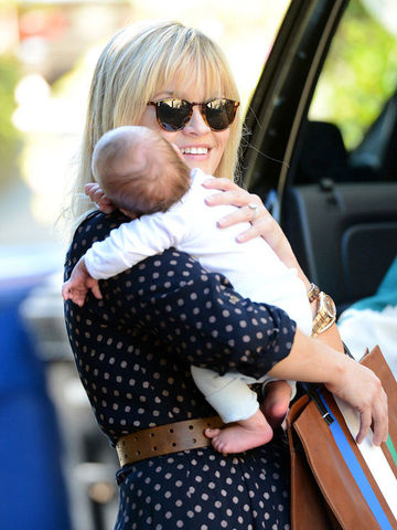 Reese Witherspoon holding Tennessee James
