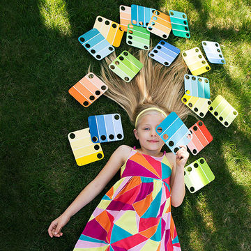 Girl Lying on Grass With Paint Chips