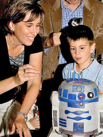 Tracy with son Justin and his R2-D2 cake