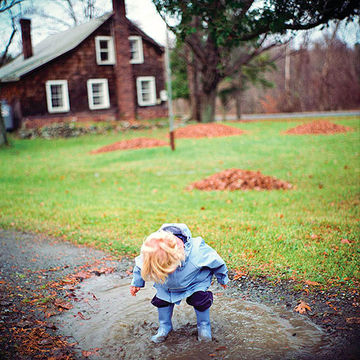 Child stomping in puddle