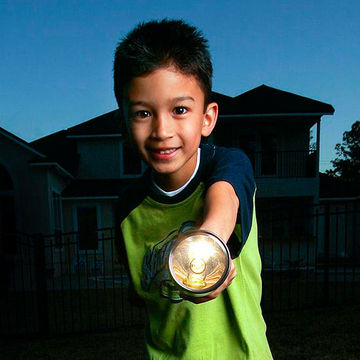 Boy in dark with flashlight