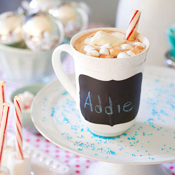 Labeled mug and candy cane stirrers
