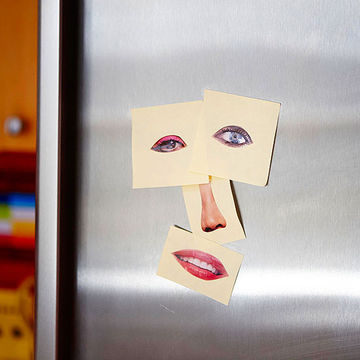Paper face on fridge