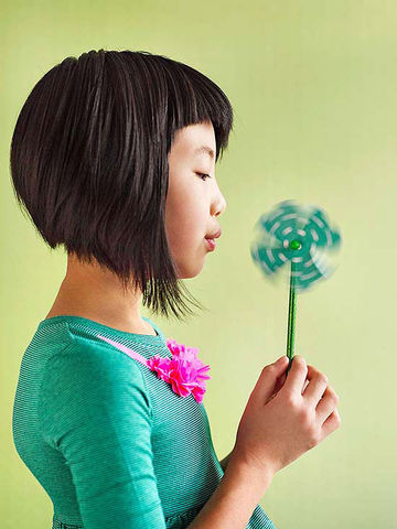 Girl blowing Spinning Shamrock