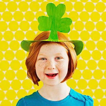 Girl in shamrock paper plate hat