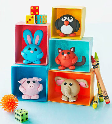 5 Clay Critters in colorful stacked boxes