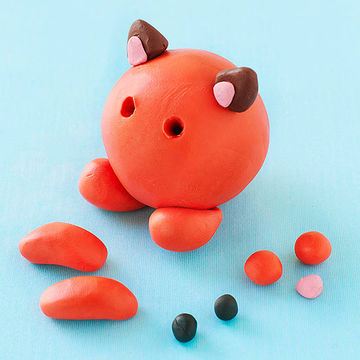 Partially finished orange polymer clay cat