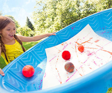 Alt TextGirl holding pool with paper and four balls inside
