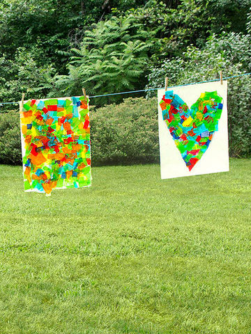 Two Mega Collages hanging from clothesline