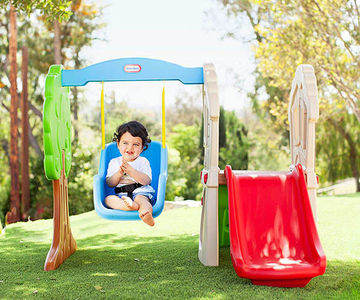Baby in Hide & Seek Climber & Swing