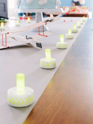 Yellow-and-white runway markers along table