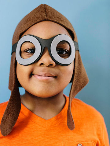 Boy in homemade pilot cap and goggles