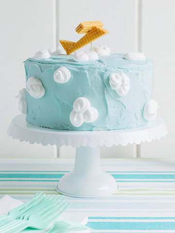 Blue cake with clouds and sugar wafer plane