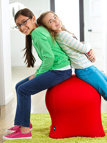 Two girls on red Pac Man ghost chair