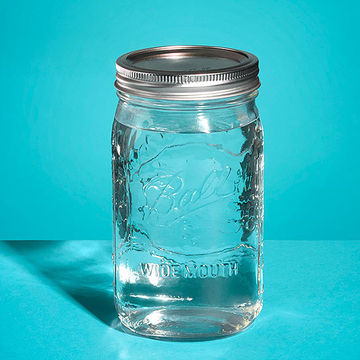 Cover the penny with a mason jar filled with water