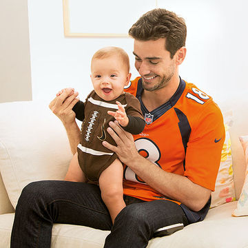 Baby and Father in Football gear