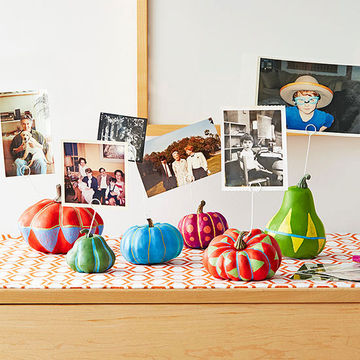 Photos sticking out of colorful gourds