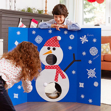 kids playing snowman game board