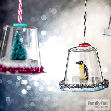 Penguin mini snow globe ornament with others in background