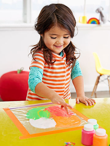 Girl doing paint in bags activity