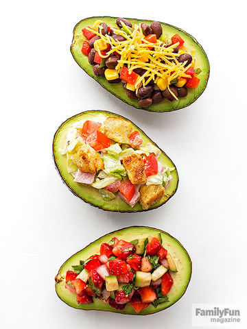 Three avocados with different toppings