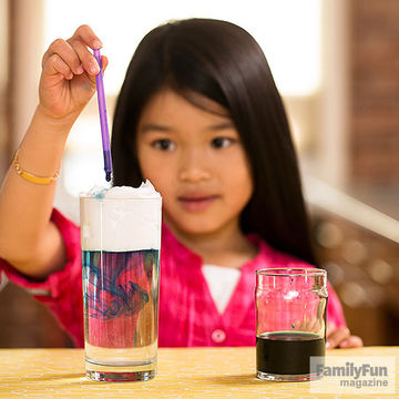 child doing science experiment