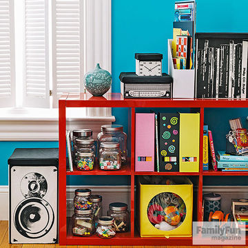 ed bookcase full of jars and binders with storage units on top